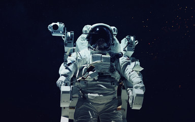 Astronaut at spacewalk. Cosmic art, science fiction wallpaper. Beauty of deep space. Billions of galaxies in the universe. Elements of this image furnished by NASA