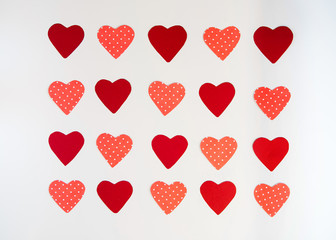 Valentines day background, red and pink hearts on a white background, pattern of hearts