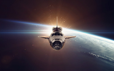Wall Mural - Space shuttle taking off on a mission. Elements of this image furnished by NASA