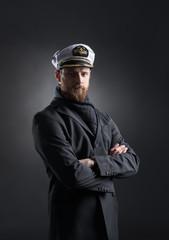 Portrait of a handsome sailor on a dark background