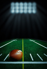 Illuminated football field at night