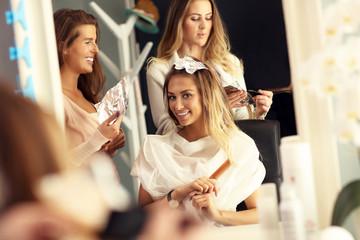 Woman dyeing hair in salon