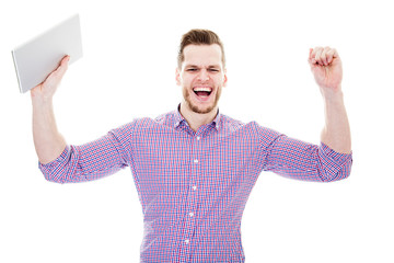 excited young businessman celebrating victory , screaming and ra