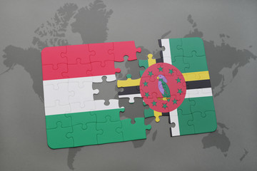 puzzle with the national flag of hungary and dominica on a world map