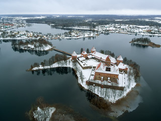 Trakai, Lithuania: aerial winter UAV top view, flat lay of gothic Island Castle and city of Trakai