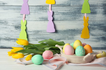 Easter eggs and decorations on table