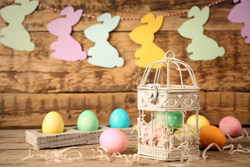 Easter eggs and decorations on wooden background