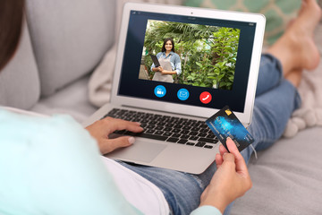 Video call and chat concept. Modern communication technology. Woman ordering flowers delivery online via laptop.