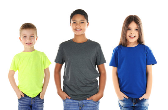 Children wearing different t-shirts on white background