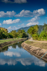 Irrigation canal with blue sky