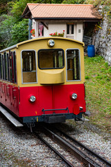 A cog wheel train decending in the Swiss Alps