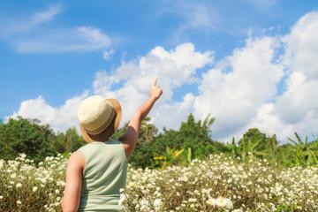 Asia teenage girl happy relax in Chrysanthemum field background sky blue.
