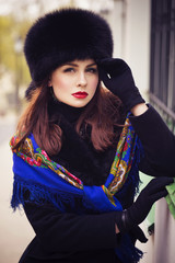 Beautiful brunette russian noblewoman outdoors on autumn day. re
