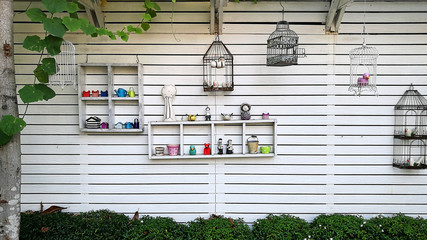 decorative wall with shelf make from white wood in garden texture background