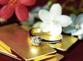 Diamond Ring on Gold Bar Flower Background