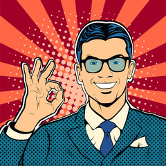 Successful businessman okay gesture OK. Business concept success. Retro style pop art. Vector illustration.
