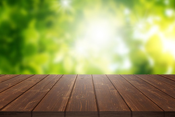 Empty wood table top on green bokeh background