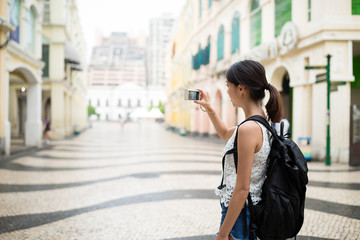 Woman taking photo in Macao