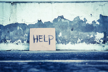 Help sign paper on the grungy wall,poverty concept and ideas Wall mural