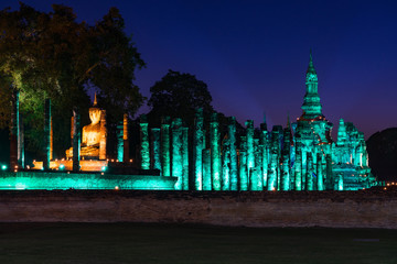 Wall Mural - sukhothai historical park illuminated in the night, Thailand