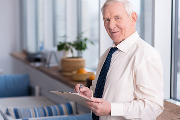 Mature businessman perusing a document