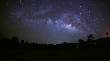 Panorama beautiful milky way galaxy on a night sky and silhouett