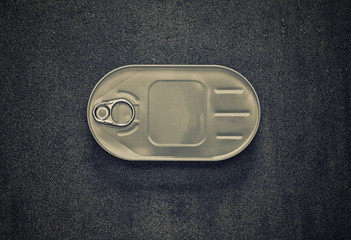 closed cans in the oval package on a gray background, top view