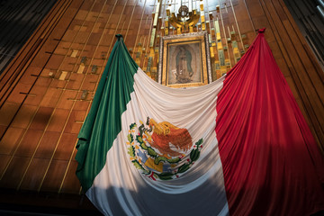 Image of the Virgin of Guadalupe and a mexican flag at the Basilica of Guadalupe in Mexico City