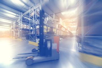 blurred warehouse interior wirh moving forklift