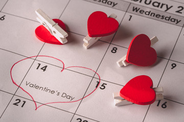 Calendar page with red heart mark valentines day 14 February