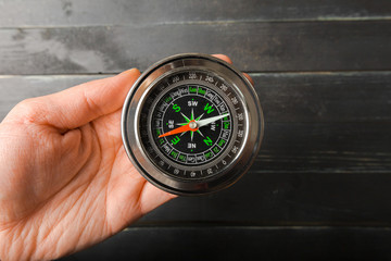 Man Hand Holding Chrome Compass