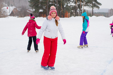 young beautiful skater girl on the ice