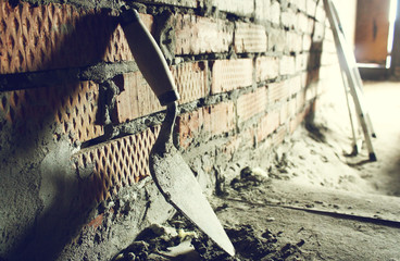 Trowel on a brick wall background