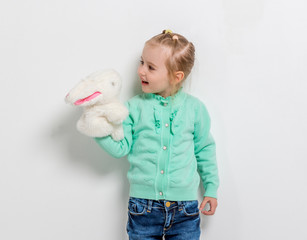 cute smiling girl playing toy hare
