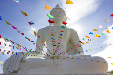 beautiful white buddha statue with thailand flag line