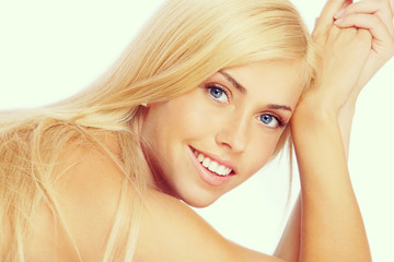 Vintage style portrait of young beautiful happy smiling girl with bare face make-up and long blond hair
