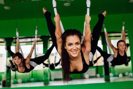 Aero fly fitness trainer workout. white hammocks.