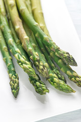 Bunch of cooked asparagus on the plate