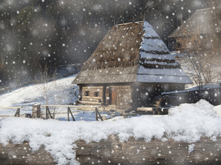 Old house in winter, snowfall. January. Country house in snow.