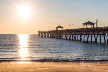 Dawn's early light on the fishing pier at Buckroe Beach in Hampton, Virginia.