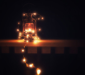 Vintage magic lantern with lights at night