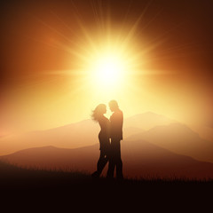 Silhouette of a couple in a sunset landscape