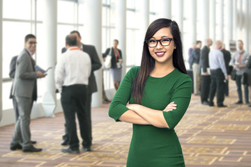 Confident business woman at a conference workshop social corporate event seminar