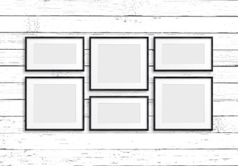 Collage of black wooden frames on old white painted  panels wall. Retro style	 mock up