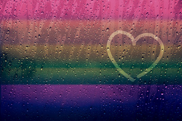 Lonely Heart Shape Drawn on glass window with Rainbow Gradient Color and droplet, Gay and Homosexual Love concept