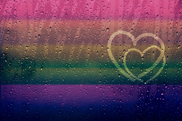 Couple of Heart Shape Drawn on glass window with Rainbow Gradient Color and droplet, Gay and Homosexual Love concept