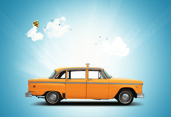Taxi, retro car orange color on the sky background