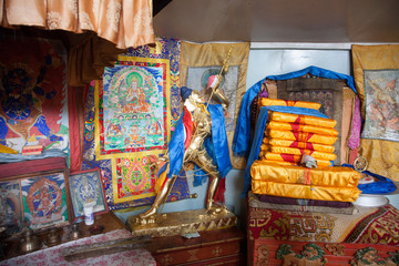 The interior is a small Mongolian Buddhist temple