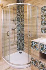 Modern bathroom interior with wood and blue pattern tile