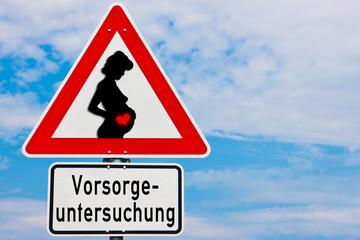 Schild mit schwangerer Frau Vorsorgeuntersuchung